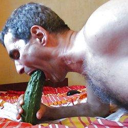 Sucking a cucumber